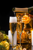 Pouring Festive Champagne into Pair of Flutes Royalty Free Stock Photography