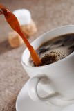 Pouring  Fresh  Brewed Coffee in white cup Royalty Free Stock Image