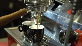Pouring fresh coffee into a ceramic cup. Close upEspresso machine pouring fresh coffee into a ceramic cup stock video