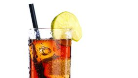 Pouring fresh coke with lime slice and ice cubes isolated on white background stock video footage