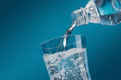 Pouring fresh water into a glass Royalty Free Stock Image