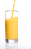Pouring fresh orange juice Royalty Free Stock Images