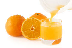Pouring fresh orange juice. Royalty Free Stock Photo