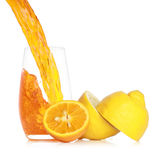 Pouring fresh orange juice into a glass Stock Photography