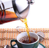 Pouring fresh tea kettle into green cup Stock Photo