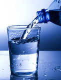 Pouring fresh water into a glass royalty free stock photo