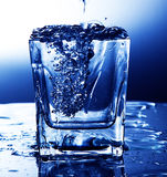 Pouring fresh water into a glass royalty free stock images