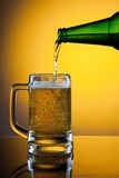 Pouring full mug of beer Stock Photography