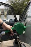 Pouring Gasoline. Loading Fuel Through a Gasoline Pump Nozzle Royalty Free Stock Images