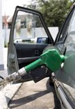 Pouring Gasoline. Loading Fuel Through a Gasoline Pump Nozzle Royalty Free Stock Photography