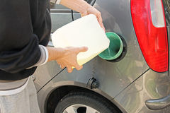 Pouring gasoline into the gas tank Royalty Free Stock Images