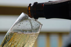 Pouring a glass of champagne Royalty Free Stock Photo