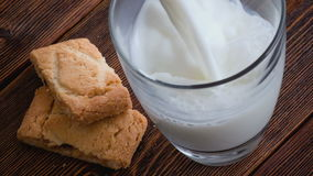 Pouring glass of milk and cookies stock video footage