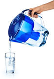 Pouring a glass of purified water  on white background. Stock Photos