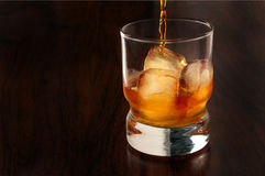 Pouring a glass of Whiskey Stock Photos