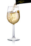 Pouring a glass of white wine isolated on white Stock Photography