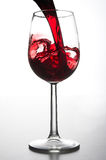 Pouring a glass of wine. Red wine being poured into a wine glass Royalty Free Stock Image