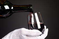 Pouring glass of wine Stock Images