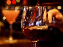 Pouring glass of wine Stock Photography