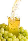 Pouring grape juice Stock Images