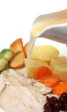 Pouring graving on Xmas dinner Stock Photography