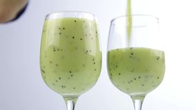 Pouring green detox smoothie into a glass. healthy eating concept stock video