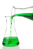 Pouring green solutions Stock Image