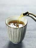 Pouring green tea Royalty Free Stock Images