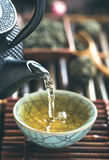 Pouring green tea vertical closeup Stock Image