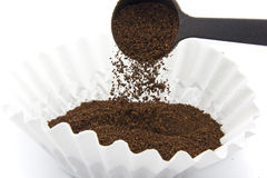 Pouring ground coffee Stock Images