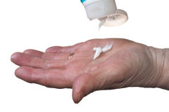 Pouring hand lotion Stock Photography