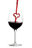 Pouring a heart of red wine Royalty Free Stock Photos