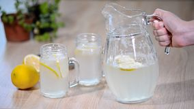 Pouring homemade lemonade soda drink to glass with lemon. Pouring homemade lemonade soda drink to glass with lemon stock video
