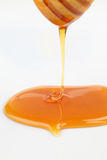 Pouring honey Royalty Free Stock Photography