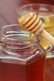 Pouring honey Stock Photos