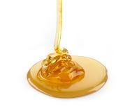 Pouring honey Stock Photo