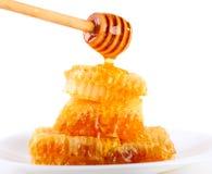 Pouring honey Royalty Free Stock Photos