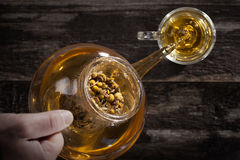 Pouring Hot Chamomile Tea. In a clear Glass Royalty Free Stock Images