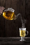 Pouring Hot Chamomile Tea. In a clear Glass Royalty Free Stock Photography