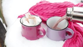 Pouring hot chocolate in the cup stock footage