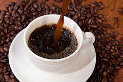 Pouring hot coffee Stock Photo
