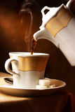 Hot coffee pouring in a cup Stock Image