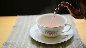 Pouring hot tea Royalty Free Stock Images