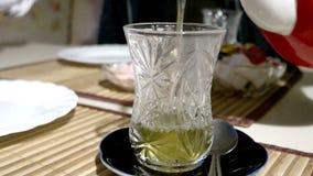 Pouring hot turkish tea into glass macro 4k. UHD stock footage