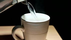 Pouring hot water into a coffee cup