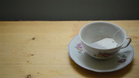 Pouring hot water on tea Royalty Free Stock Photos
