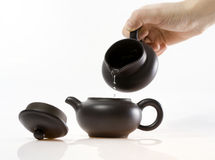 Pouring hot water in teapot Stock Photography