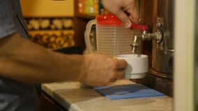 Pouring hot water to cup for brewing tea at cafe. Pouring hot water to white cup for brewing tea at cafe stock video footage