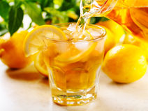 Pouring ice tea into glass Stock Photos