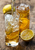 Pouring iced tea with lemon Royalty Free Stock Photography